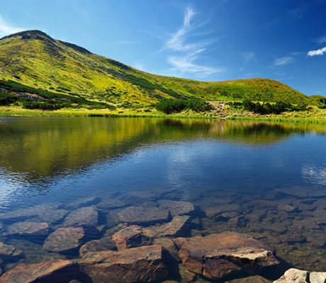 Mountain lake and green hills